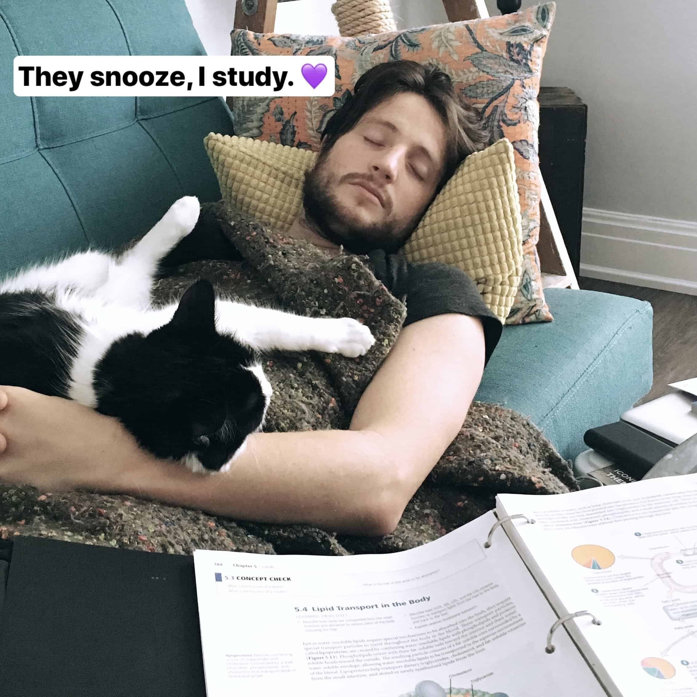 Man and a cat napping on a couch.
