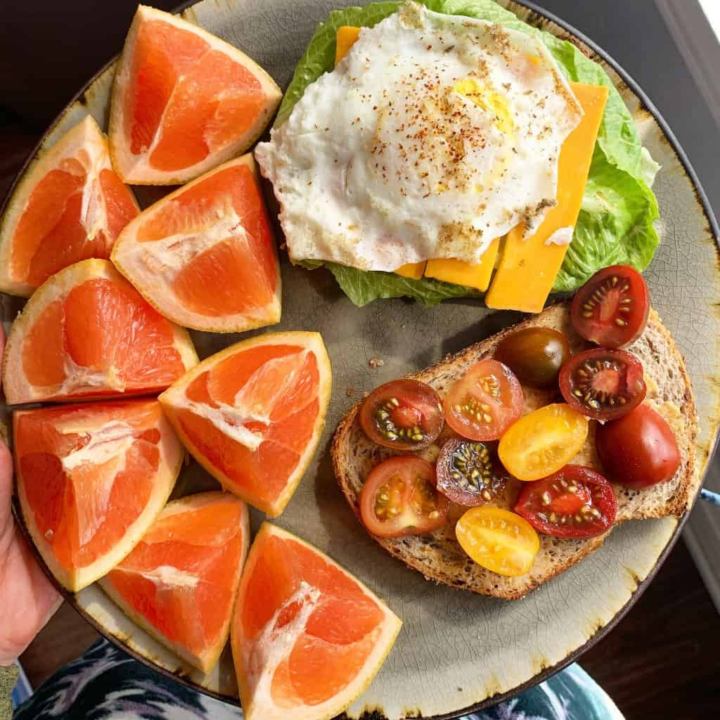 Open-face egg sandwich with grapefruit, relationship with food